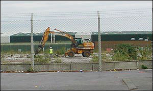 Workers cleaning the former Atomic Weapons Establishment, Cardiff