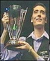 Chris Small beats a serious spinal condition and Alan McManus to clinch the LG Cup in Preston.