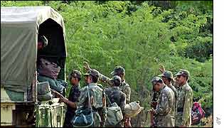 Indian troops load up their baggage in town of Bhuj