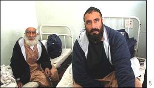 Former Afghan detainees Haji Faiz Mohammed, left, and Jan Mohammed, who were freed from Guantanamo in October