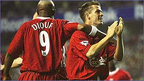 Michael Owen and his team-mates celebrate another goal