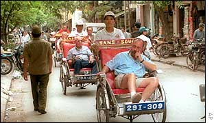 Cyclo carrying tourist around Hanoi 