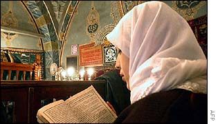 Turkish girl reads Koran at Hadji Bayram mosque in Ankara