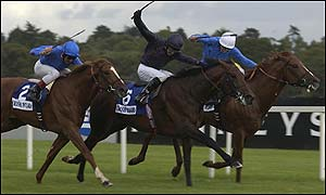 Grandera makes his winning challenge against Hawk Wing and Best of the Bests in the Irish Champion Stakes