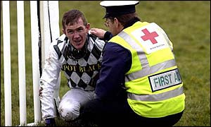 Tony McCoy is treated by a first aid officer after taking a tumble at Newbury in January, 2002
