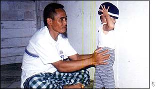 Undated family photo of Amrozi with a child, obtained by Indonesian daily Surya
