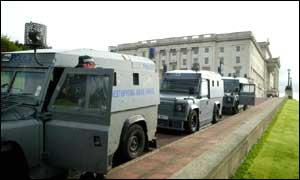 Police raided Sinn Fein's Stormont office and houses in Belfast