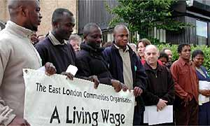 A group of workers protesting at low pay