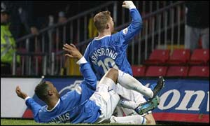 Ipswich striker Alun Armstrong celebrates scoring against Watford with Fabian Wilnis