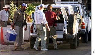 Unscom team loads a vehicle, 1998