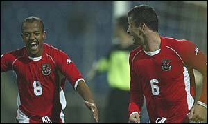 Gary Speed is congratulated by Robert Earnshaw after scoring