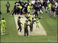 Jubilant Bangladeshi fans stream onto the pitch