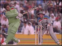 Pakistan's Inzamam-ul-Haq hits another boundary as New Zealand's Ian Smith looks on