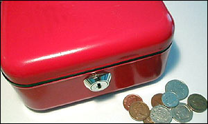 A red moneybox and some coins