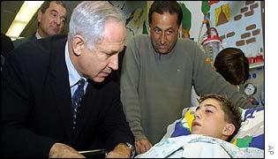 Likud contender Binyamin Netanyahu visits Jerusalem bus bomb victim