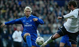 Bolton's Paul Warhurst challenges Chelsea's Eidur Gudjohnsen