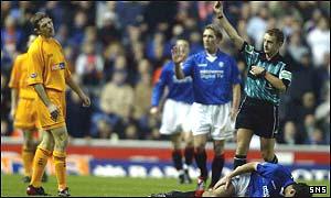Sean Kilgannon is shown the red card