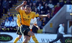 Celtic's Henrik Larsson scores from the penalty spot