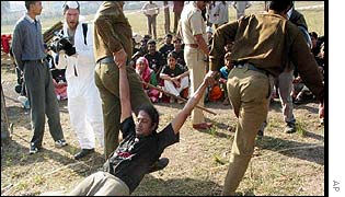 An activist being dragged away by police