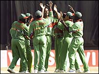 Kenya celebrate another wicket