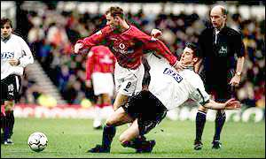 Derby's Brian O'Neill tangles with Man Utd's Nicky Butt