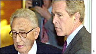 Henry Kissinger (L) and President George W Bush