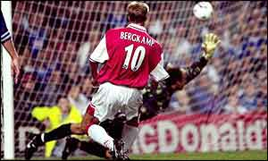Dennis Bergkamp scores his third against Leicester in 1997