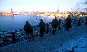 People look out over the Stockholm skyline