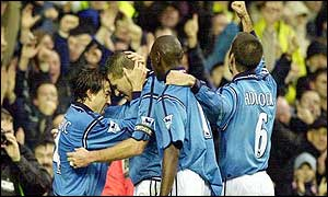 Manchester City's Steve Howey (2nd left) is congratulated by team mates