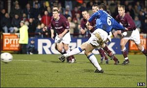 Barry Ferguson slots home a penalty kick