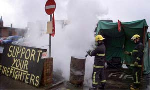 Firefighters clean up their picket lines