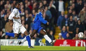 Everton's Joseph Yobo (left) looks on as Chelsea's Jimmy Floyd Hasselbaink scores
