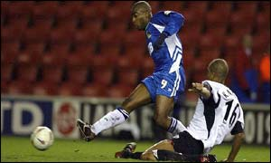 Wigan striker Nathan Ellington scores to send his side through to the quarter-finals