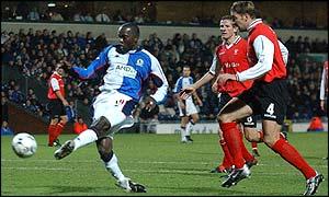 Blackburn striker Dwight Yorke scores his second goal against Rotherham