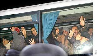 Refugees leaving the Sangatte refugee centre