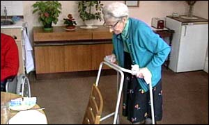 Woman uses zimmer frame