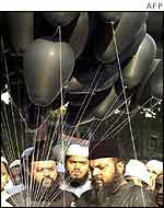 Muslims carry black balloons as part of a silent protest in Bombay