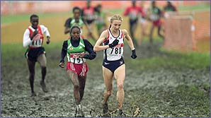 Paula Radcliffe battles through the mud