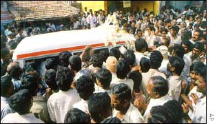 Villagers accompany the body of former minister H Nagappa to his home in Kamagere
