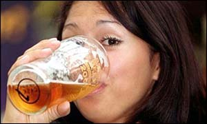Woman drinks pint of beer