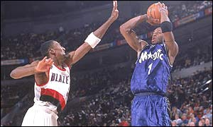 Tracy McGrady goes for a jump shot against Scottie Pippen of the Portland Trailblazers