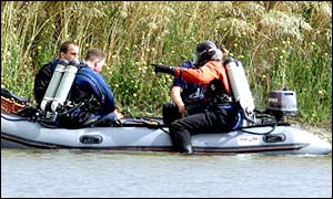 Police divers in boat