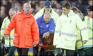 Joseph-Desire Job is carried off after his clash of heads with Darren Moore