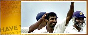 Muttiah Muralitharan (c) takes his 400th test wicket