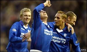 Barry Ferguson celebrates opening the scoring for Rangers
