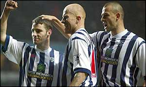 Koumas (left) celebrates his goal with team-mates Lee Hughes and Neil Clement