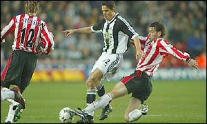 Southampton's Rory Delap tackles Newcastle's Laurent Robert