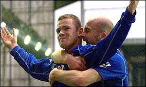 Wayne Rooney celebrates scoring his third Premiership goal