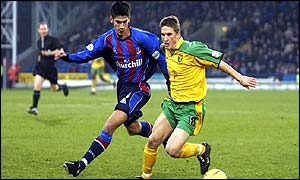 Norwich's Paul McVeigh evades Danny Butterfield