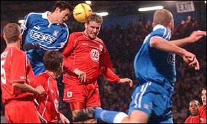 Cardiff's Fan Zhiyi attempts a header on goal